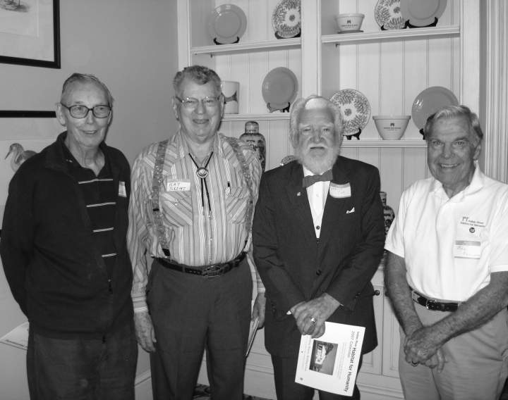[caption: Pictured left to right:  Bob Walsh, Ray Scent, Charlie Cox and Bill Elliot] A black and white photo of the four founders